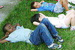 Children laying in grass