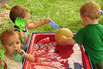 Children at a water table