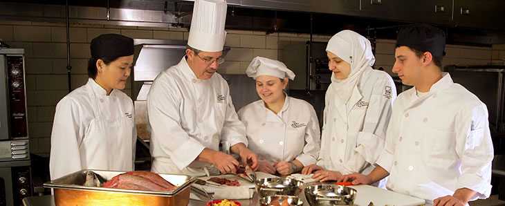 Students learning from a chef