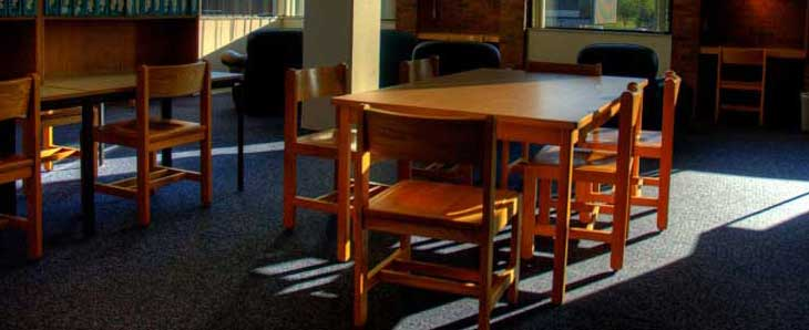 Photo of library tables and study areas.