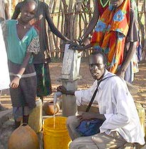 Photo of villagers with Water for Sudan sign
