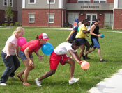 students engaging in a balloon race