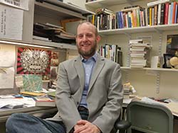Photo of Professor Scott Rudd in his office