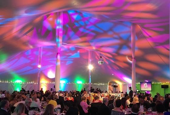 Photo of the Gala - bright lights and designs on the ceiling with people sitting at tables