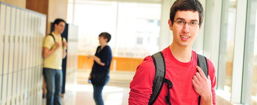 Photo of male student in a campus hallway