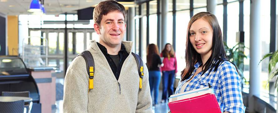 Photo of two students smiling