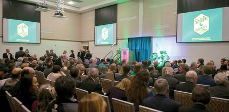 Photo of guests in the high-tech event space of the Downtown Campus, the site of the Monroe County Executive's State of the County Address in May.