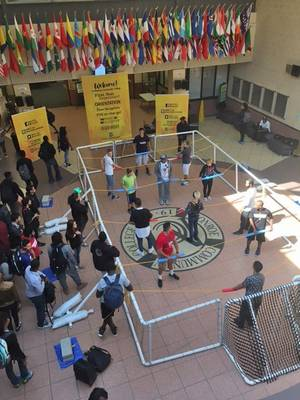 human foosball game in atrium