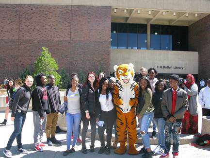 students on Buff State campus with Benji the Bengal mascot