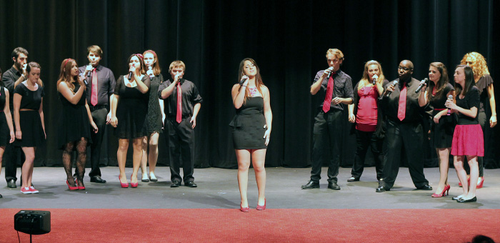 hoto of MCC co-ed vocal ensemble performing on stage.